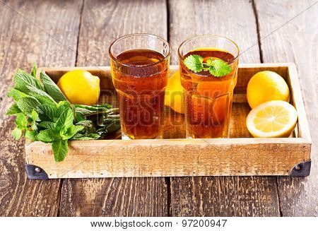 Glasses Of Ice Tea With Mint And Lemon