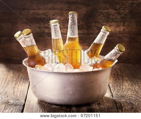 Cold Bottles Of Beer In Bucket With Ice