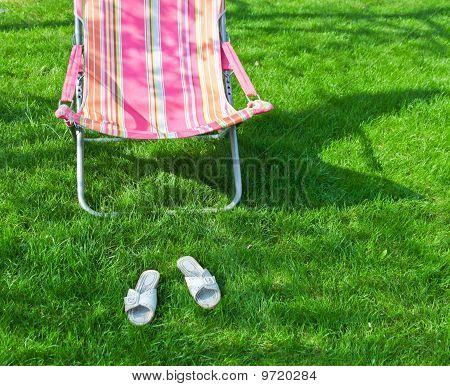 Chaise Lounge On A Lawn