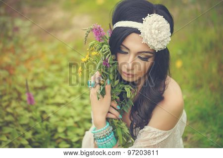 Boho Girl With Bouquet Of Wildflowers.
