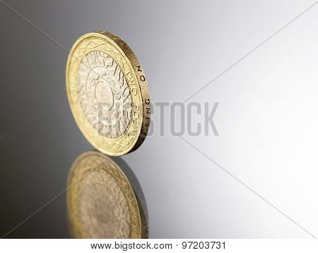 two pound  on top of glass table