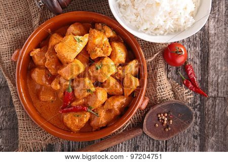 curry chicken with sauce and rice