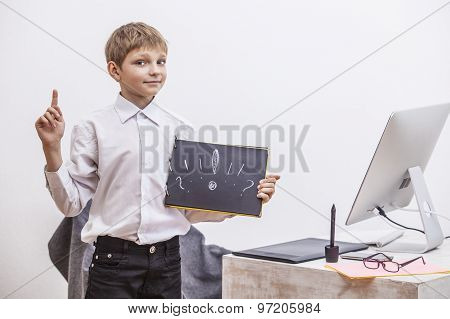 Boy Child With A Computer, In The Office In A White Shirt Businessman