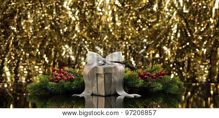 Silver Present And Christmas Tree Branches