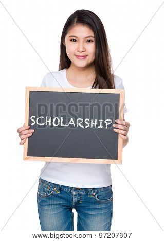 Young woman hold with chalkboard and showing a word scholarship
