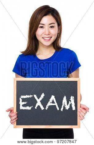 Asian woman hold with chalkboard and showing a word exam