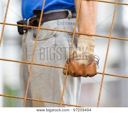 Worker Carrying Reinforcement Mesh