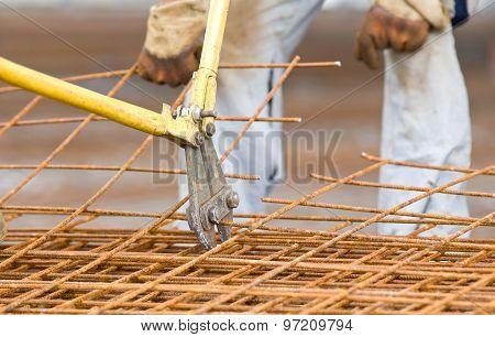 Worker Cutting Reinforcement Mesh