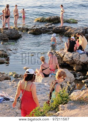 Sevastopol, Crimea, July, 24, 2015: Vacationers bathe on the bank of the Black Sea in Sevastopol, the Crimea