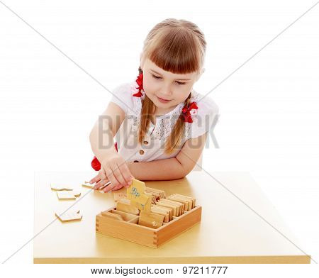 little girl in a Montessori kindergarten