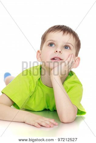 little boy lying on the floor