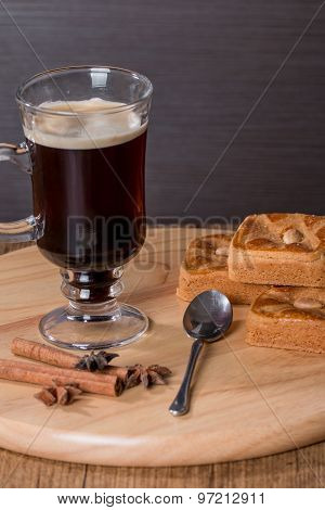 Glass Cup Of Coffee And Cinnamon Stick With Almond Cookies