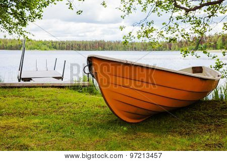 Summer Landscape With Lake And Boat