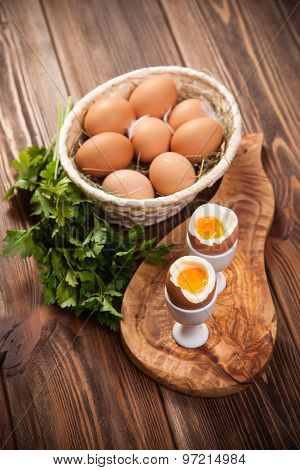 Boiled eggs on a wooden background.