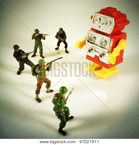 Vintage style Toy Soldiers shooting at robot with an Instagram style filter