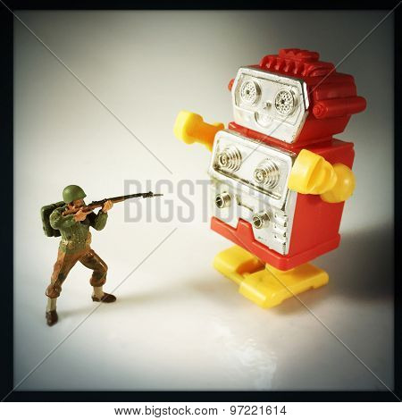 Vintage style Toy Soldier shooting at robot with an Instagram style filter