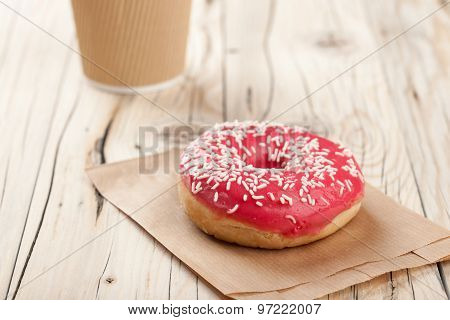 Donut And Paper Cup On Wooden Table