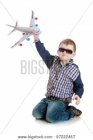 boy playing with an airplane
