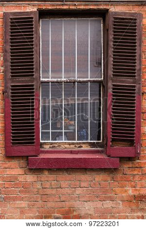 Window With Worn Out Wooden Shutters