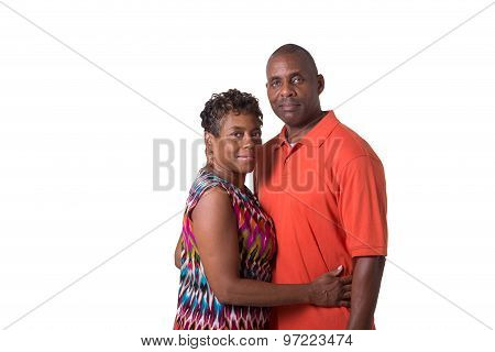 Portrait of an older couple standing close, isolated