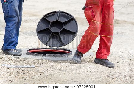Workers Beside Manhole