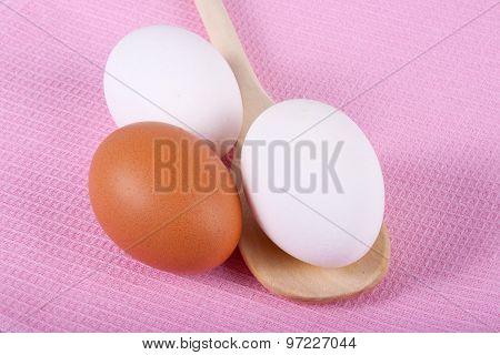 Three Eggs On A Pink Napkin