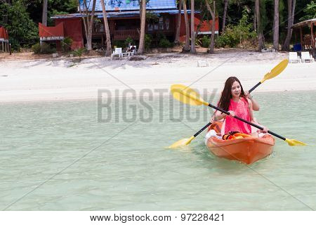 Beautiful Girl With Kayak Paddle  Travel And Vacation On The Beach Enjoying