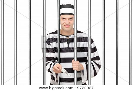 A Prisoner In Jail Giving Bribe