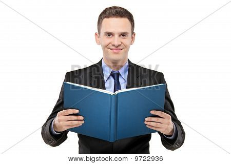 A Young Businessman Reading A Book