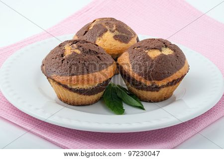 Three Tasty Muffins On A White Plate