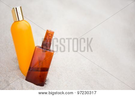 Skin Care Concept -suntan Lotion Bottles In Sand
