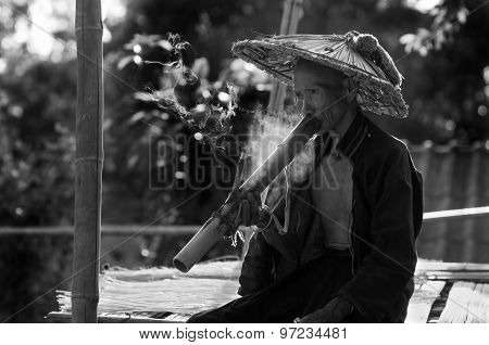 Hill Tribe Man Smokes Marijuana