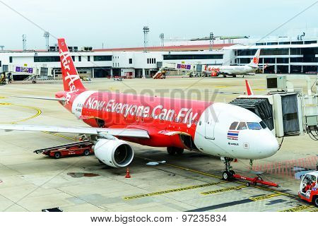 Airliner Air-asia Maintenance Checking During Refueling And Loading Baggage
