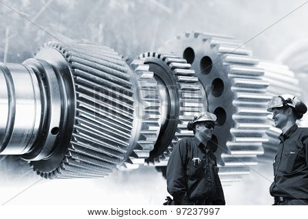 industrial engineers, workers with large cogwheels and gears machinery, metal blue toning concept with focal-point on workers