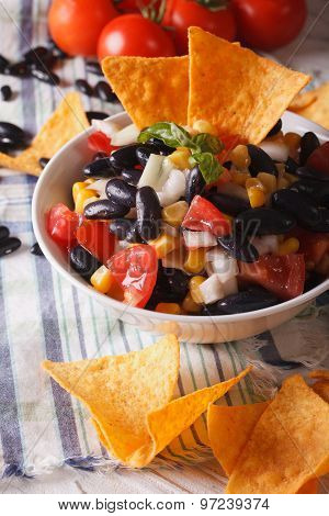 Mexican Food: Salsa With Black Beans And Nachos Closeup. Vertical