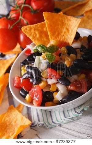 Mexican Food: Salsa In A Bowl And Corn Chips Nachos Macro. Vertical