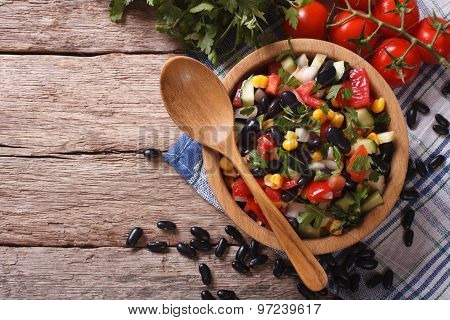 Mexican Vegetable Salad In A Wooden Bowl, Close-up Horizontal Top View