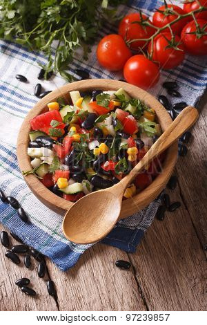 Vegetable Salad With Black Beans And Ingredients On The Table. Vertical