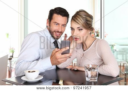 Surprised Happy Couple Looking The Smartphone At The Bar