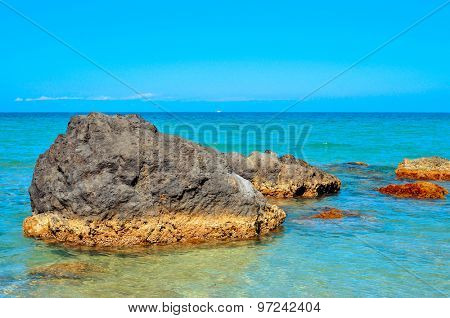 a quiet landscape of the Mediterranean Sea in Ibiza Island, Spain, with the horizon in the background
