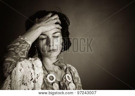 Woman with a headache.