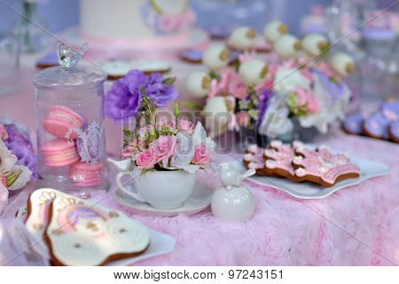table with flowers and a dessert