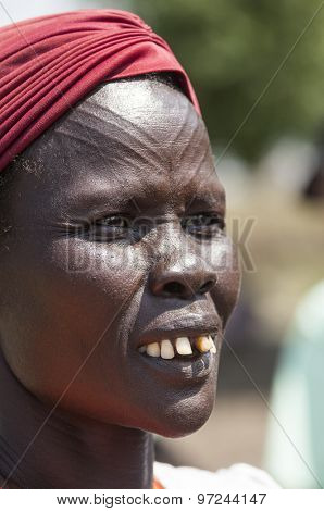 LILIIR, SOUTH SUDAN-DECEMBER 4, 2010: An unidentified Dinka tribeswoman has scarification on her forehead.