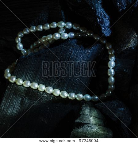 Pearl Necklace On Black Carbon