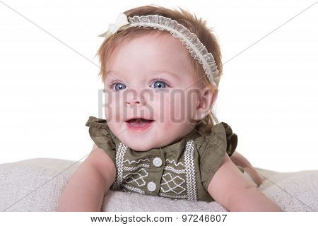 Portrait of a smiling 6 month old baby girl isolated