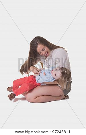 A mother and her preschool toddler, isolated