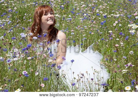 Beautiful Bride With Red Hair With Blue Flowers