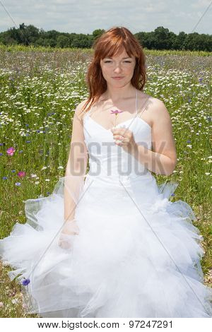 Young Bride Walking On The Flower Meadow