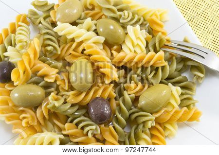 Colored Pasta With Olives Close Up