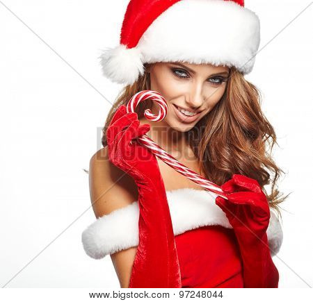 Beautiful woman with santa hat holding red -white Christmas Lollipop
